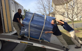Movers loading furniture