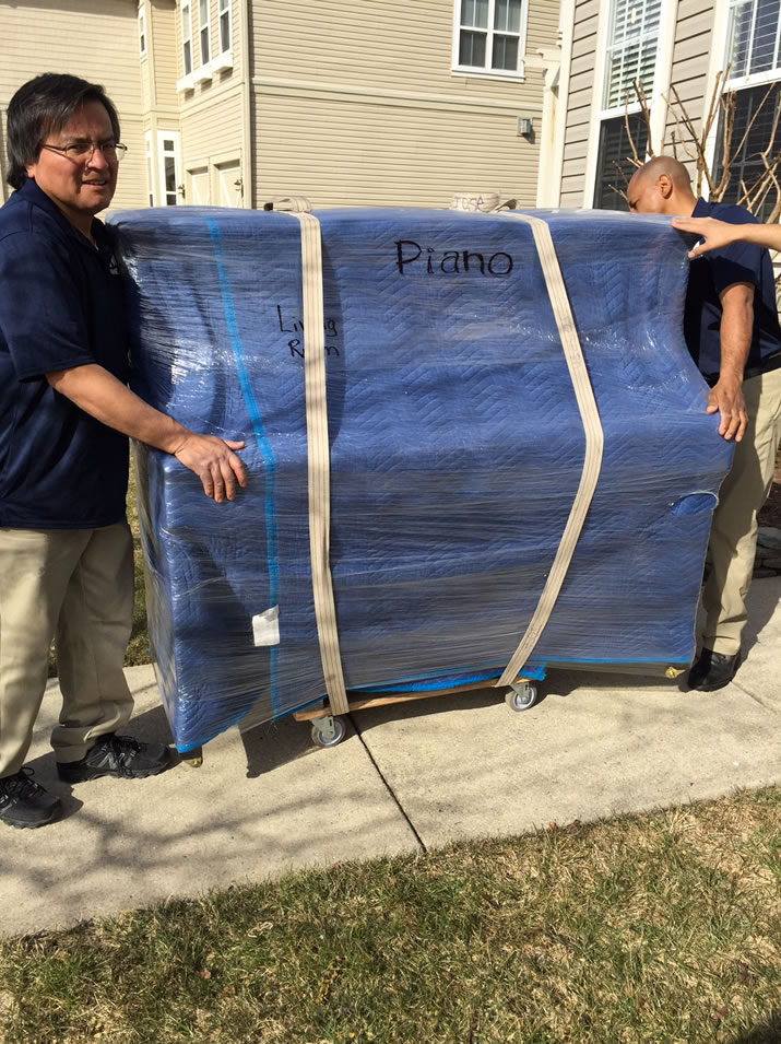 Movers moving a Piano